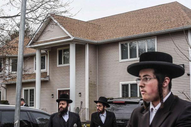 PHOTO: People gather in front of the house of Rabbi Chaim Rottenberg, Dec. 29, 2019, in Monsey, N.Y. (Stephanie Keith/Getty Images)