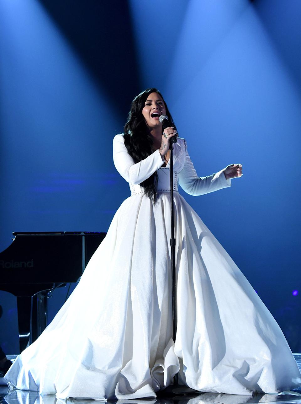 Demi on stage at the Grammys (Photo: John Shearer via Getty Images)