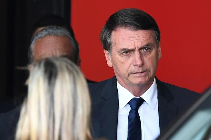 Bolsonaro's team is a mixed one, drawing heavily on ex-military men while also featuring a star judge and a liberal economist (AFP Photo/EVARISTO SA)