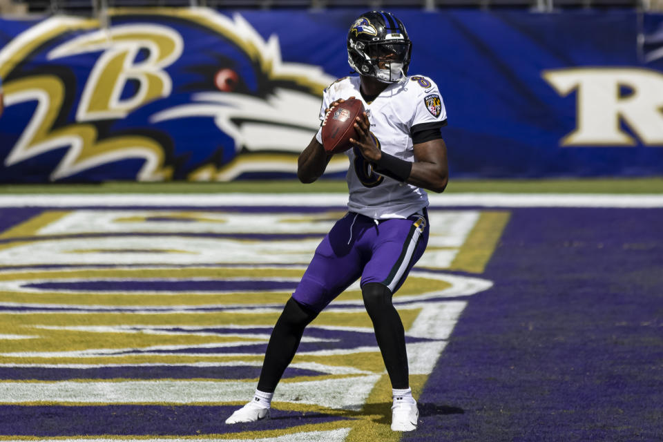 John Harbaugh is fine with his decision to keep Lamar Jackson in late during their blowout win against the Browns on Sunday. (Scott Taetsch/Getty Images)