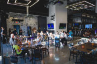 This photo provided by Adam M. Rammel shows the main dining room at The Syndicate on Aug. 20, 2020 in Bellefontaine, Ohio. Ohio's restrictions forced Adam Rammel to at least temporarily abandon plans for a catering and event space designed for parties and that opened last month, in time for the holidays. Rather than have the space sit unused, Rammel turned it into The Syndicate, a restaurant located next door to his 5-year-old brewpub, Brewfontaine. (Susie Jarvis/Adam M. Rammel via AP)