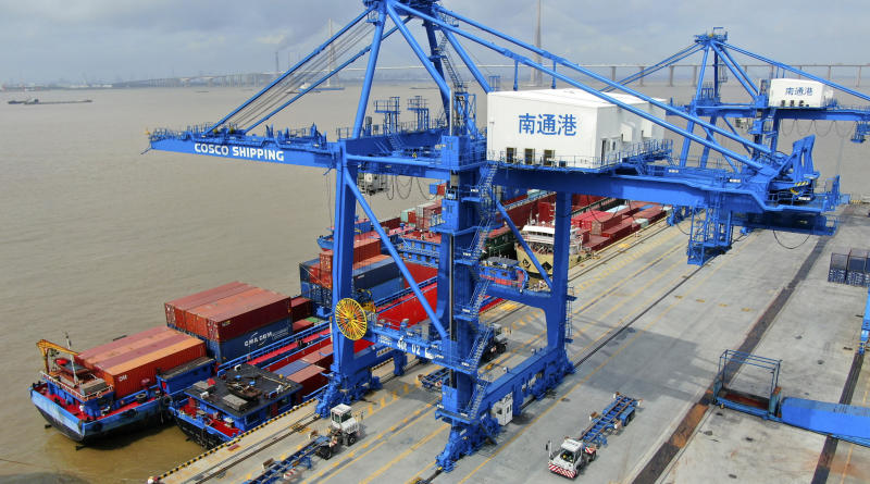 "FILE - In this July 18, 2019, file photo, shipping containers are loaded onto a cargo ship at a port in Nantong in eastern China's Jiangsu province. Beijing appealed to Washington on Wednesday, Aug. 21, to ""meet China halfway"" and end a tariff war after President Donald Trump said Americans might need to endure economic pain to achieve longer-term benefits. (Chinatopix via AP)"