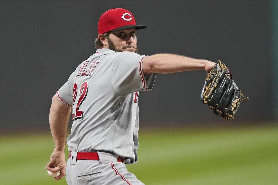 Cincinnati Reds starting pitcher Wade Miley delivers in the first inning of a baseball game against the Cleveland Indians, Friday, May 7, 2021, in Cleveland. (AP Photo/Tony Dejak)