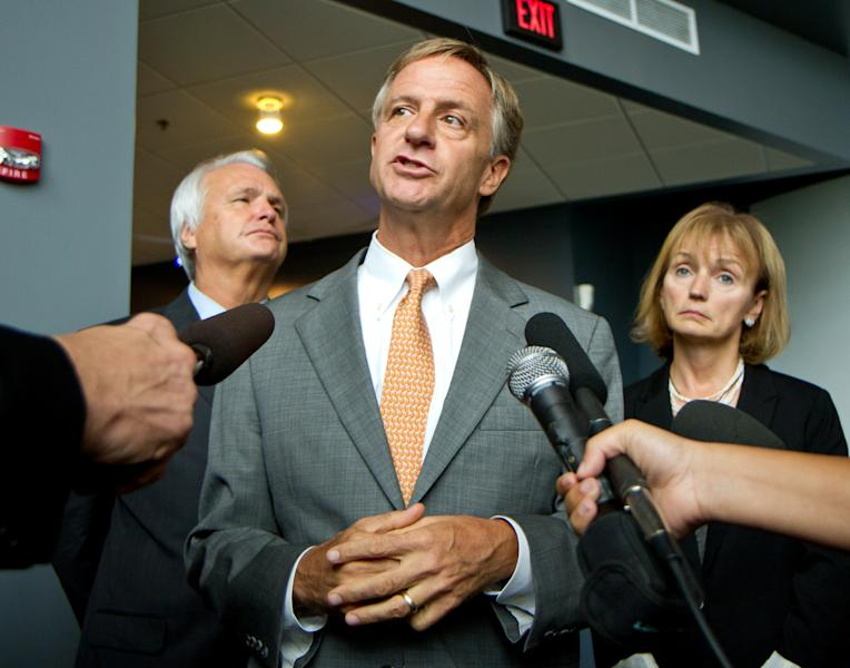 Gov. Bill Haslam speaks to reporters at the Adventure Science Center in Nashville, Tenn., on Tuesday, Sept. 18, 2012, following a ceremony to launch the state's new college savings plan. At rear are Senate Speaker Ron Ramsey, R-Blountville, and House Speaker Beth Harwell, R-Nashville. The governor said he approved Education Commissioner Kevin Huffman's decision to withhold $3.4 million in state funding from Nashville schools over a refusal to approve a charter school application. (AP Photo/Erik Schelzig)