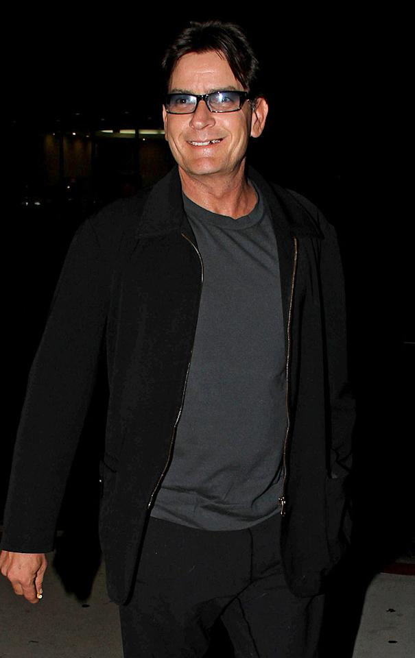 "Charlie Sheen masked that devilish twinkle he always has in his eyes with tinted glasses while grabbing dinner in Los Angeles in April. In his 1989 movie ""Major League,"" the actor memorably played a pro baseball pitcher who wore glasses with a silver skull on the front and a lightning bolt on the side. His real-life look is definitely less flashy."