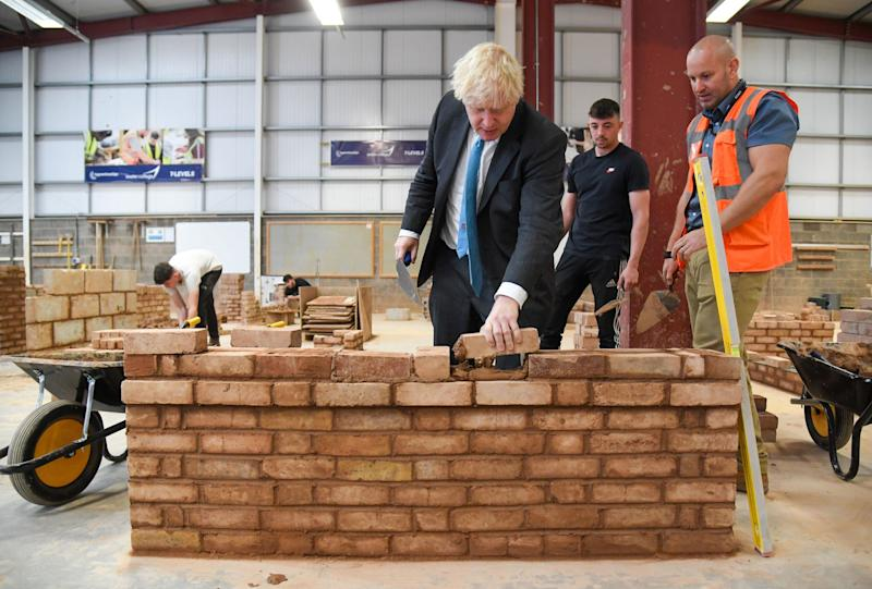 Mr Johnson did not wear a mask when he visited Exeter college(PA)