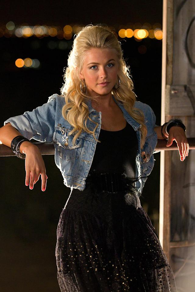 "<b>80's Curves</b><br><a>Julianne Hough</a>, an up and coming young actress, plays up and coming young actress Sherrie Christian in the film. Hough is a veteran of ""Dancing with the Stars,"" not as a star who learns to dance, but as a two-time winning dancer who led both Apolo Anton Ohno and Helio Castroneves to victory. But while dancing may have helped get her into great shape, it wasn't exactly the right shape. Hough put on 80's era curves for the shoot, so she would look the part when her road to stardom takes her along the path of so many other young starlets: stripping. ""I actually changed my diet and exercise routine a little bit because in the 80's, the women were not twig thin. They looked like they were 18-years-old and they had curves. It was all real, you know? So I definitely beefed up some of my exercises and lifted weights. Yes, I am going to be in underwear on a pole and I definitely had to focus on that,"" Hough <a href=""http://www.hitfix.com/immaculate-noise/interview-julianne-hough-on-rock-of-ages-and-a-tom-cruise-lap-dance"">told Hitfix.com. </a>"