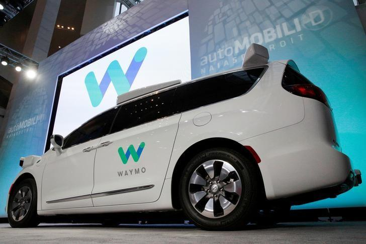 Waymo unveils a self-driving Chrysler Pacifica minivan during the North American International Auto Show in Detroit