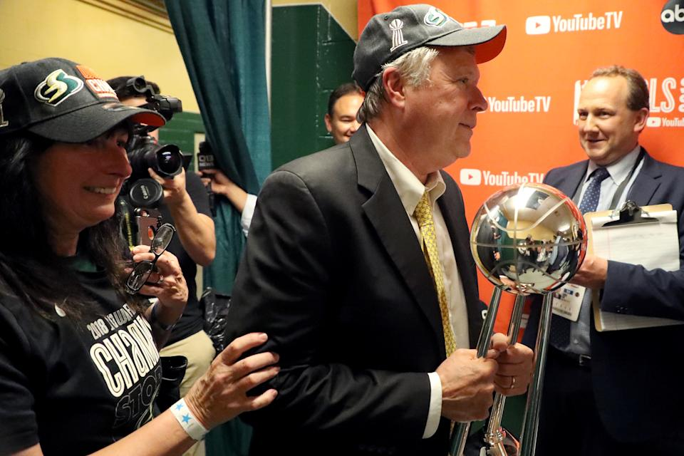 FAIRFAX, VA - SEPTEMBER 12: Head coach Dan Hughes of the Seattle Storm carries the trophy into the locker room after defeating the Washington Mystics to win the WNBA Finals at EagleBank Arena on September 12, 2018 in Fairfax, Virginia. (Photo by Rob Carr/Getty Images)