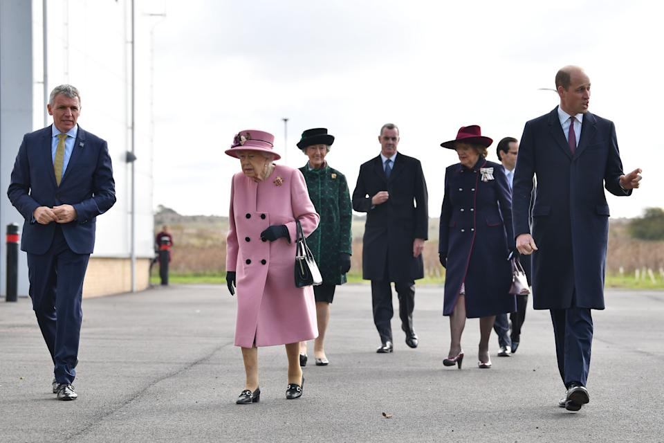 Britain's Queen Elizabeth II (C) and Britain's Prince William, Duke of Cambridge (R) arrive with Dstl Chief Executive Gary Aitkenhead (L) at the Energetics Analysis Centre as they visit the Defence Science and Technology Laboratory (Dstl) at Porton Down science park near Salisbury, southern England, on October 15, 2020. - The Queen and the Duke of Cambridge visited the Defence Science and Technology Laboratory (Dstl) where they were to view displays of weaponry and tactics used in counter intelligence, a demonstration of a Forensic Explosives Investigation and meet staff who were involved in the Salisbury Novichok incident. Her Majesty and His Royal Highness also formally opened the new Energetics Analysis Centre. (Photo by Ben STANSALL / POOL / AFP) (Photo by BEN STANSALL/POOL/AFP via Getty Images)