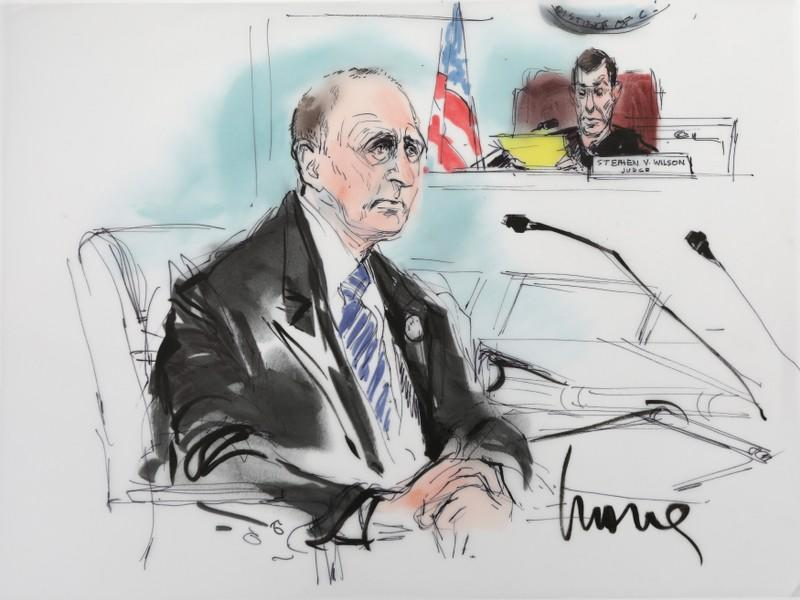 British cave diver Vernon Unsworth is shown with Judge Stephen Brown looking on in a courtroom drawing during the trial in a defamation case in which he is suing Tesla chief executive Elon Musk, in Los Angeles, California