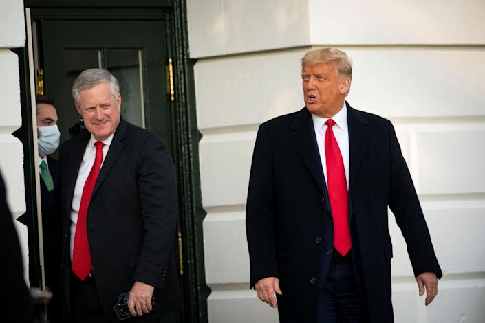 """White House Chief of Staff Mark Meadows, left, has said the goal of U.S. President Donald Trump is to """"defeat"""" the coronavirus, not """"control"""" it. (REUTERS/Al Drago)"""