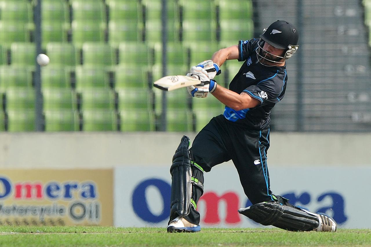 New Zealand batsman Anton Devcich plays a shot during the T20 match between Bangladesh and Zew Zealand at the Sher-e-Bangla National Cricket Stadium in Dhaka on November 6, 2013.  AFP PHOTO/ Munir uz ZAMAN        (Photo credit should read MUNIR UZ ZAMAN/AFP/Getty Images)