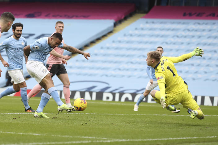 Manchester City's Gabriel Jesus scores his side's opening goal during the English Premier League match between Manchester City and Sheffield United at the the City of Manchester Stadium in Manchester, England, Saturday, Jan. 30, 2021. (Martin Rickett/Pool via AP)
