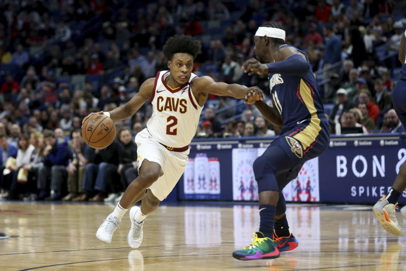 FILE - In this Feb. 28, 2020 file photo, Cleveland Cavaliers guard Collin Sexton (2) drives to the basket as New Orleans Pelicans guard Jrue Holiday (11) defends during the first half of an NBA basketball game in New Orleans.  On Friday, March 6,  Sexton, Andre Drummond,   and Darius Garland, forwards Cedi Osman, Dante Exum and Dylan Windler, coach J.B. Bickerstaff, his entire staff and general manager Koby Altman, spent several hours visiting with offenders at Grafton a medium security prison housing 1,700 residents to share fellowship as well as some hope and hoops.(AP Photo/Rusty Costanza, File)