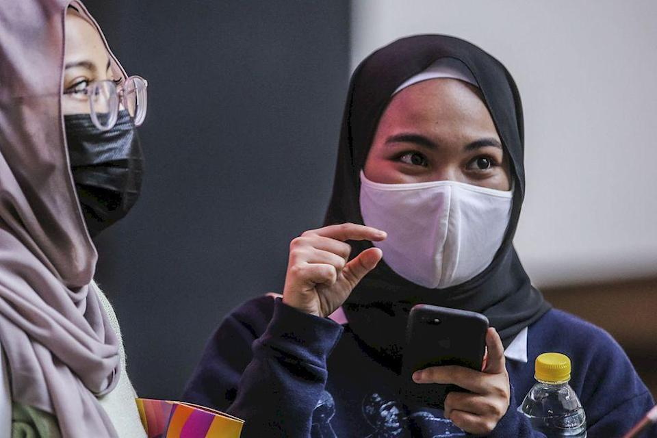 Alia Izzah (right) speaking to Malay Mail reporters at Mid Valley shopping centre cinema, March 5, 2021. ― Picture by Hari Anggara.