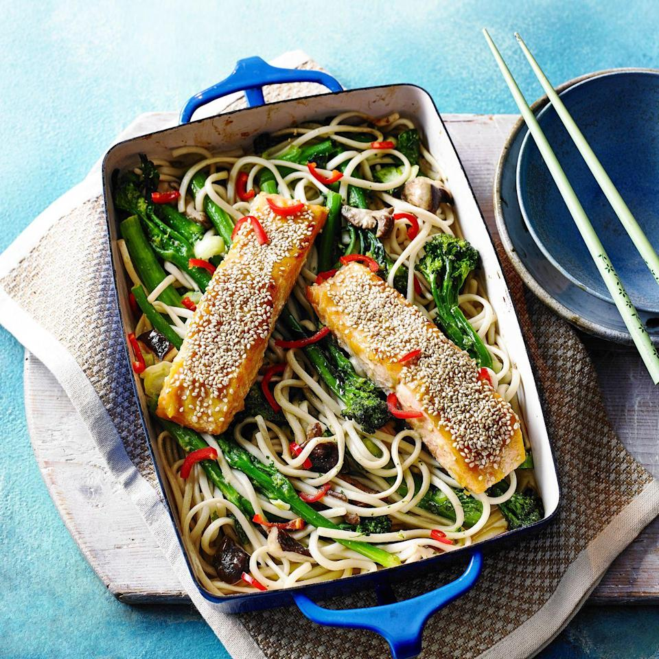 """<p>Salmon and miso are a wonderful combination. If you like, use chestnut mushrooms instead of shiitake for a cheaper option.</p><p><strong>Recipe: <a href=""""https://www.goodhousekeeping.com/uk/food/recipes/a29316741/salmon-noodle-traybake/"""" rel=""""nofollow noopener"""" target=""""_blank"""" data-ylk=""""slk:Miso Salmon and Noodle Traybake"""" class=""""link rapid-noclick-resp"""">Miso Salmon and Noodle Traybake</a></strong></p>"""