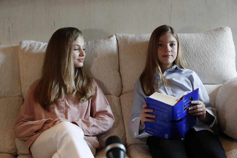 MADRID, SPAIN - APRIL 23: In this handout photo provided by Casa de S.M. el Rey Spanish Royal Household, Princess Leonor of Spain (L) and Princess Sofia of Spain (R) read El Quijote book during the XXIV edition of continuous reading of El Quijote at the Zarzuela Palace on April 23, 2020 in Madrid, Spain. (Photo by Casa de S.M. el Rey Spanish Royal Household via Getty Images)