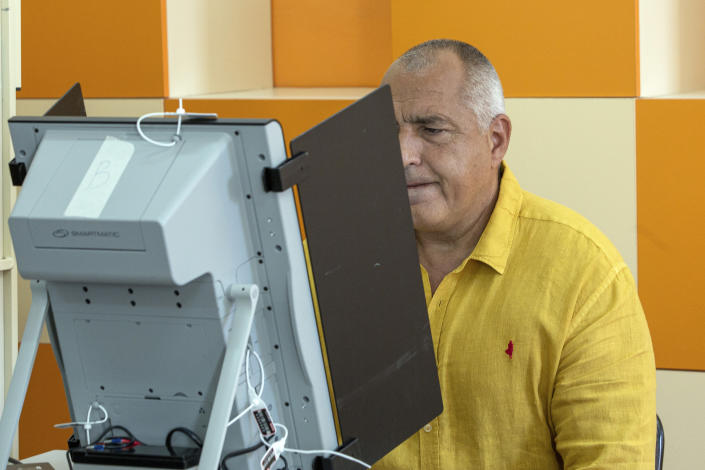 Bulgarian former prime minister Boyko Borissov electronically casts his ballot during parliamentary elections in the town of Bankya near capital Sofia, Bulgaria on Sunday, July 11, 2021. Bulgarians are voting in a snap poll on Sunday after a previous election in April produced a fragmented parliament that failed to form a viable coalition government. Latest opinion polls suggest that the rerun could produce similar results but also a further drop in support for former Prime Minister Boyko Borissov's GERB party, after the current caretaker government made public allegations of widespread corruption during his rule. (AP PHOTO/Visar Kryeziu)