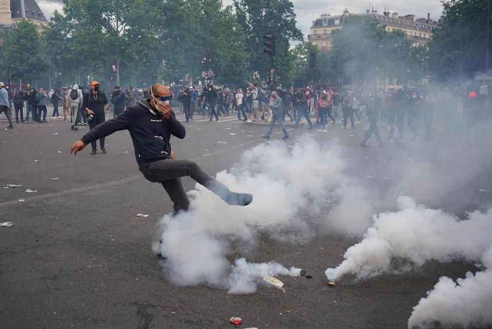 PARIS, FRANCE - JUNE 13, 2020:  Paris riot police fired tear gas to disperse a largely peaceful but unauthorised protest supporting the movement Black Lives Matter protest against brutality and racism near Place de la Republique. Gatherings of more than 10 people are currently banned in France due to coronavirus containment measures.  PHOTOGRAPH BY Abdulmonam Eassa / Barcroft Studios / Future Publishing (Photo credit should read Abdulmonam Eassa/Barcroft Media via Getty Images)