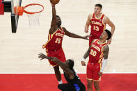Atlanta Hawks' Clint Capela (15) rejects New York Knicks' Julius Randle's shot (30) during the second half in Game 3 of an NBA basketball first-round playoff series Friday, May 28, 2021, in Atlanta. (AP Photo/Brynn Anderson)