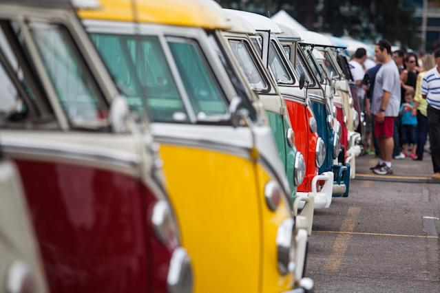 SAO BERNARDO DO CAMPO, BRAZIL - DECEMBER 8: Volkswagen Kombi minibuses are lined up during an exhibition of the vehicles on December 8, 2013 in Sao Bernardo do Campo, Brazil. The event celebrates the last of the iconic Volkswagen minibuses to come off the assembly line in Brazil, which was the last country to manufacture them. (Photo by Victor Moriyama/Getty Images)