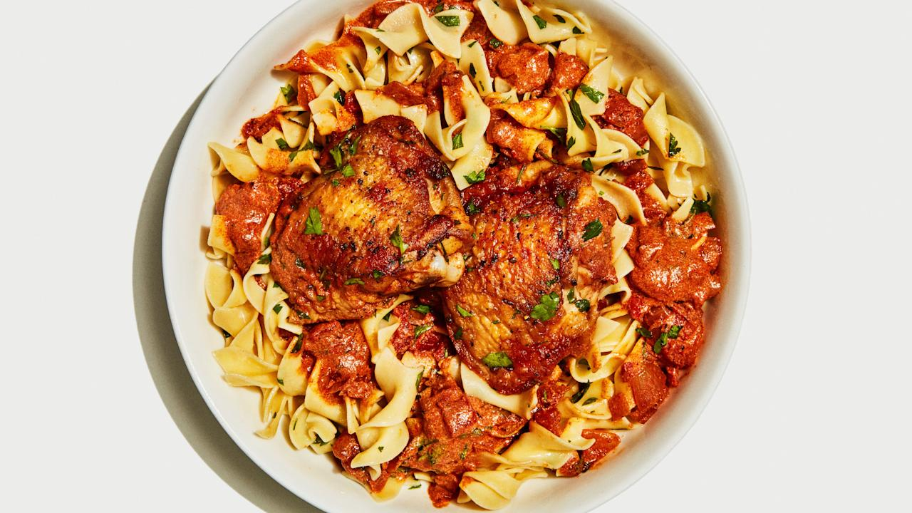 "What's more comforting than saucy chicken over buttered egg noodles?? Nothing. To ensure the silkiest, noodle-coating sauce, make sure the sour cream is room temperature so it blends seamlessly into the hot tomato sauce (otherwise, it might separate and give the sauce a curdled look). <a href=""https://www.bonappetit.com/recipe/chicken-paprikash-with-buttered-egg-noodles?mbid=synd_yahoo_rss"">See recipe.</a>"