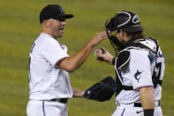 Miami Marlins relief pitcher Brandon Kintzler, left and catcher Chad Wallach celebrate after a baseball game against the Philadelphia Phillies, Monday, Sept. 14, 2020, in Miami. (AP Photo/Lynne Sladky)