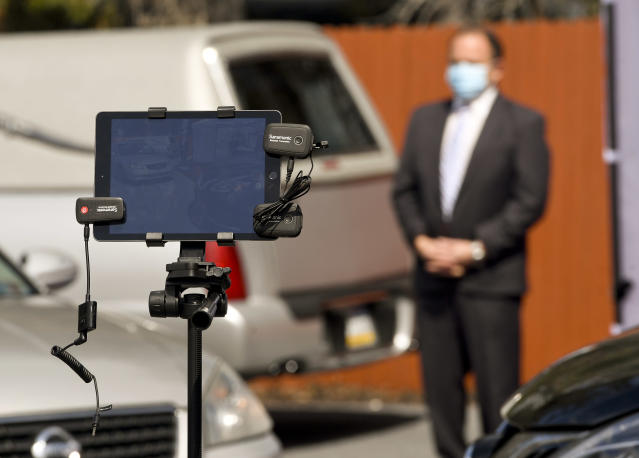 A tablet ran a live video feed of the Stitzel Family Funeral Home in Muhlneberg, Pa., where a drive-up viewing allows mourners to pay their respects while maintaining social distancing during the Coronavirus / COVID-19 crisis. (Photo: Ben Hasty/MediaNews Group/Reading Eagle via Getty Images)
