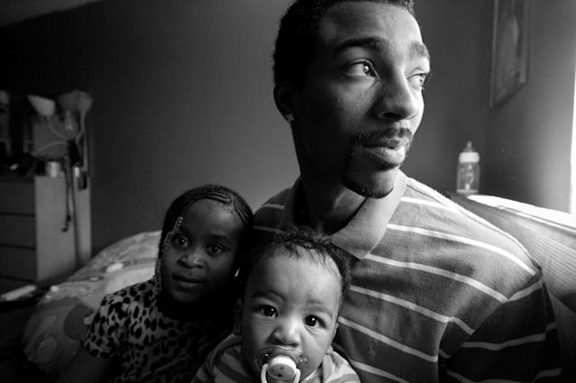 <p>Guy Miller at home with daughter Nijeyah and newborn son Guy Jr., Bronx, N.Y., (Photograph © Zun Lee) </p>