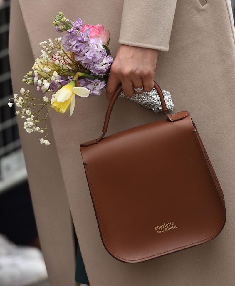 Meghan carries the Charlotte Elizabeth 'Bloomsbury' bag in Northern Ireland in March 2018 [Photo: PA]