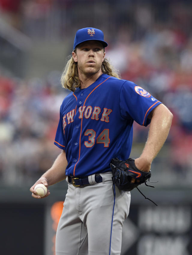 New York Mets starting pitcher Noah Syndergaard reacts after giving up an RBI-double to Philadelphia Phillies' Asdrubal Cabrera during the first inning of a baseball game against the Philadelphia Phillies, Friday, Aug. 17, 2018, in Philadelphia. (AP Photo/Michael Perez)