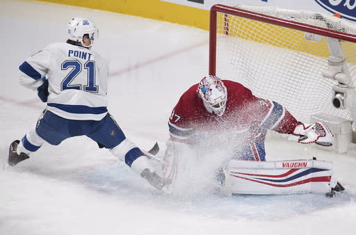 Montreal Canadiens goaltender Antti Niemi (37) makes a save against Tampa Bay Lightning center Brayden Point (21) during third-period NHL hockey game action in Montreal, Saturday, Feb. 24, 2018. (Graham Hughes/The Canadian Press via AP)