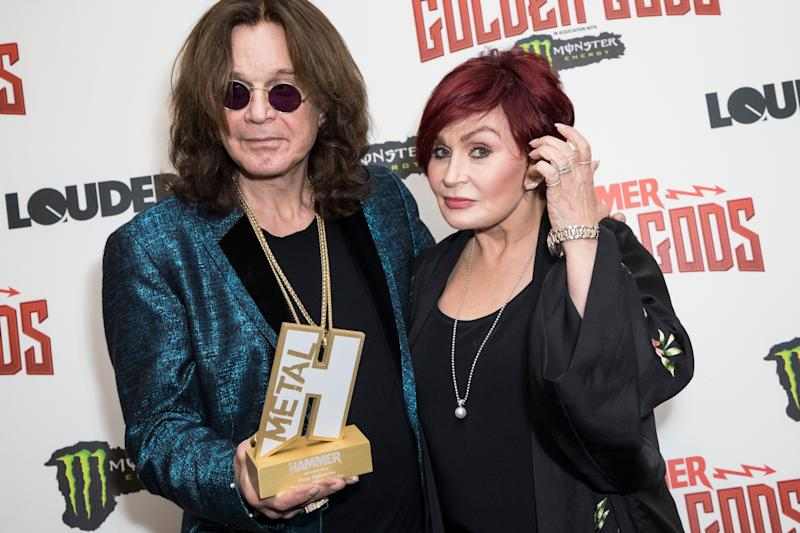 Musician Ozzy Osbourne, left, and his wife Sharon Osbourne pose for photographers after Ozzy received the Golden God award at the Metal Hammer Golden God awards, in London, Monday June 11, 2018. (Photo by Vianney Le Caer/Invision/AP)