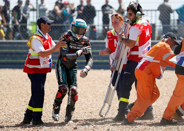 Motorcycling - Moto3 - French Grand Prix - Bugatti Circuit, Le Mans, France - May 19, 2018 Petronas Sprinta Racing's Adam Norrodin with stewards after coming off his bike during qualifying REUTERS/Gonzalo Fuentes