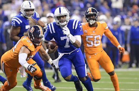 Dec 14, 2017; Indianapolis, IN, USA; Indianapolis Colts quarterback Jacoby Brissett (7) runs for a first quarter touchdown against the Denver Broncos at Lucas Oil Stadium. Mandatory Credit: Thomas J. Russo-USA TODAY Sports