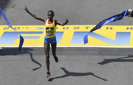 Atsede Baysa of Ethiopia crosses the finish line to win the womenv¢Ç¨Ñ¢s division of the 120th running of the Boston Marathon in Boston, Massachusetts April 18, 2016. REUTERS/Gretchen Ertl    Picture Supplied by Action Images