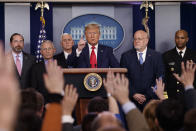 "FILE - In this Feb. 29, 2020, file photo President Donald Trump, center, points as he prepares to answer question after speaking about the coronavirus in the press briefing room at the White House in Washington, as Health and Human Services Secretary Alex Azar, National Institute for Allergy and Infectious Diseases Director Dr. Anthony Fauci, Vice President Mike Pence, Robert Redfield, director of the Centers for Disease Control and Prevention and U.S. Surgeon General Dr. Jerome Adams listen. Public health officials were already warning Americans about the need to prepare for the coronavirus threat in early February when President Donald Trump called it ""deadly stuff"" in a private conversation that has only now has come to light. (AP Photo/Carolyn Kaster, File)"