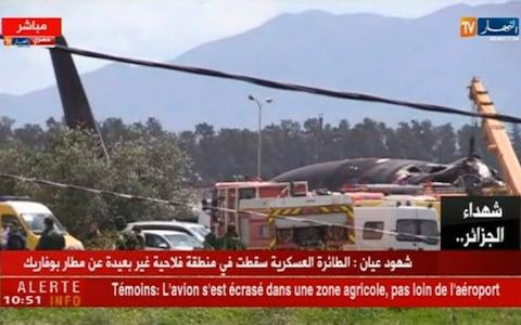 emergency services at the scene after a military plane crashed soon after takeoff at Boufarik military base - Credit: ENNAHAR TV/AP