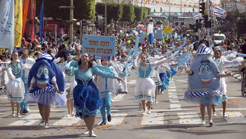 Dressed up Israelis take part in a parade to celebrate the Jewish holiday of Purim on February 24, 2013 in the central Israeli city of Netanya. (Jack Guez/AFP/Getty Images)