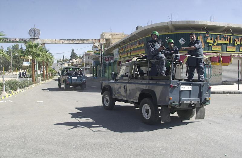 A file picture taken on November 13, 2002 shows Jordanian security forces patrol the empty streets of the southern town of Maan