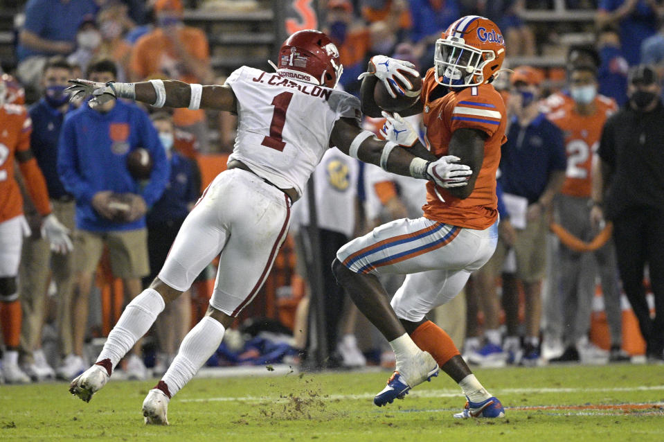 Florida wide receiver Kadarius Toney, right, breaks free after catching a pass in front of Arkansas defensive back Jalen Catalon during the first half of an NCAA college football game Saturday, Nov. 14, 2020, in Gainesville, Fla. (AP Photo/Phelan M. Ebenhack)
