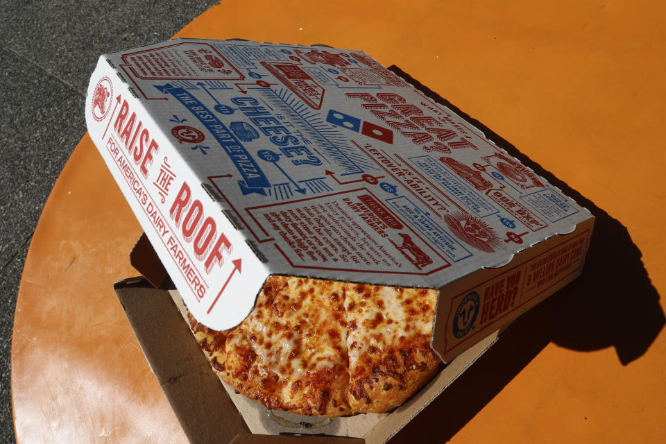 This is a small Domino's pizza made in a Domino's Pizza shop in downtown Pittsburgh Monday, July 15, 2019. (AP Photo/Gene J. Puskar)