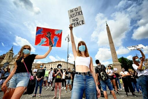 """Protesters carried placards and played drums during a rally in solidarity with the """"Black Lives Matter"""" movement in Rome"""