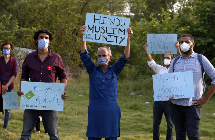 Members of a civil society group hold a demonstration demanding the government allow the construction of a Hindu temple, in Islamabad, Pakistan, Wednesday, July 8, 2020. A senior political figure, allied with the government and backed by Islamic extremists, stopped the construction of the temple. Analysts and activists say minorities in Pakistan are increasingly vulnerable to Islamic extremists as Prime Minister Imran Khan vacillates between trying to forge a pluralistic nation and his conservative Islamic beliefs. (AP Photo/Anjum Naveed)