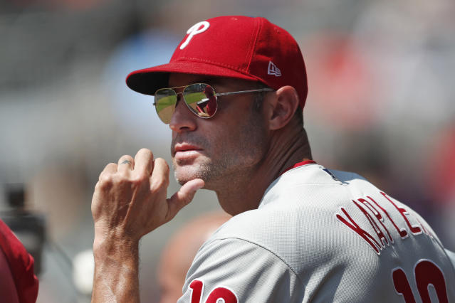 FILE - In this Sept. 19, 2019, file photo, Philadelphia Phillies manager Gabe Kapler (19) watches from the dugout during a baseball game against the Atlanta Braves, in Atlanta. The Phillies fired Kapler Thursday, Oct. 10, 2019.(AP Photo/John Bazemore, File)