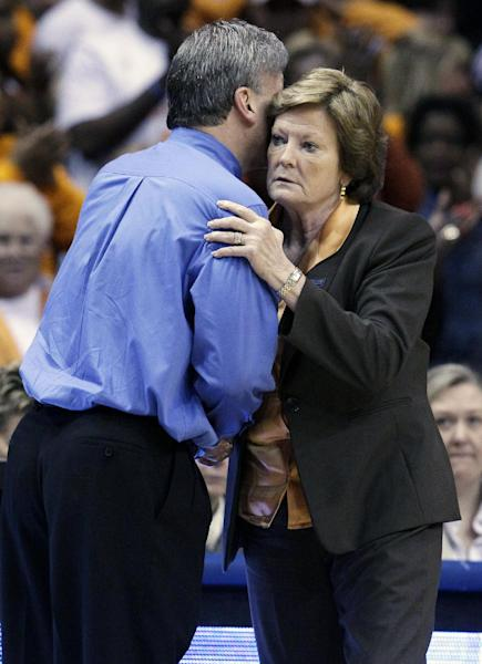 Tennessee head coach Pat Summitt, right, hugs with DePaul head coach Doug Bruno after Tennessee defeated DePaul 63-48 in an NCAA tournament second-round women's college basketball game in Rosemont, Ill., Monday, March 19, 2012. (AP Photo/Nam Y. Huh)