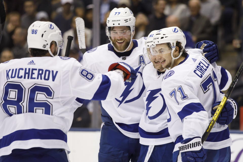 Tampa Bay Lightning right wing Nikita Kucherov (86), defenseman Victor Hedman (77), center Steven Stamkos (91) and center Anthony Cirelli (71) celebrate a goal against the Toronto Maple Leafs during the first period of an NHL hockey game Thursday, Oct. 10, 2019, in Toronto. (Cole Burston/The Canadian Press via AP)