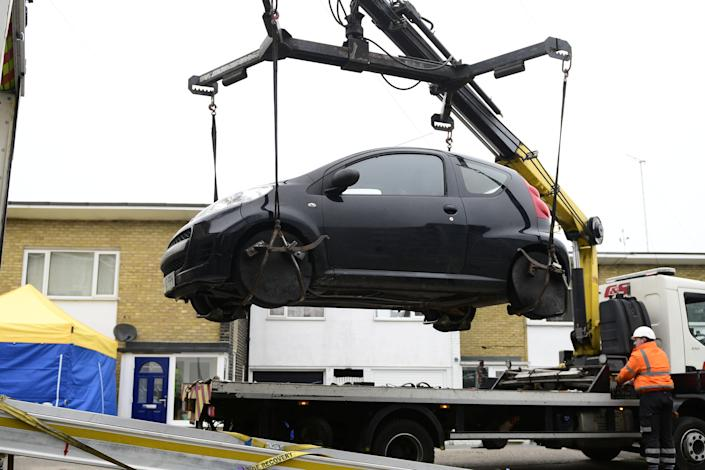 A vehicle is removed from outside a property in Ashford, Kent, earlier this week during police investigations. (SWNS)