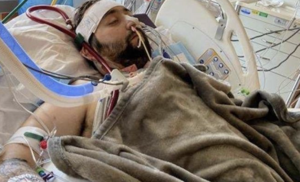 Blake Bargatze, 24, is pictured in a hospital bed.